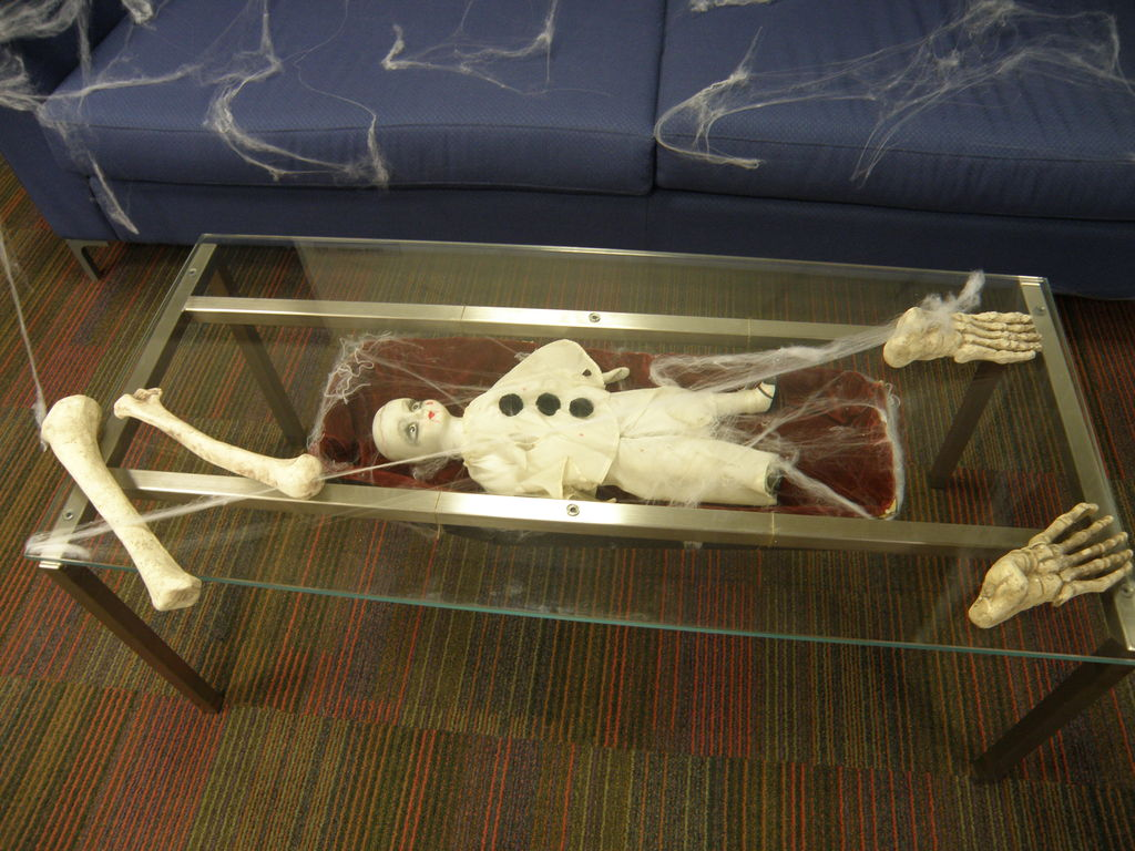 Office halloween decorations ideas - Glass Table Coffin