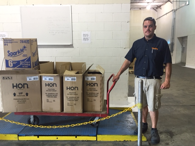 Thrifty Office Furniture Donation to Food Bank CENC